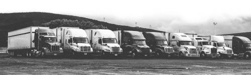 Black and white of semi's parked in a row